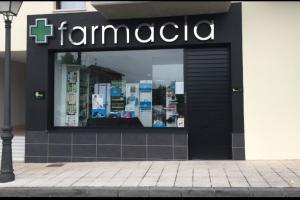Farmacia Sariego , Principado de Asturias , obra de instalación de expendedora 24 horas .